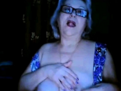 Russian grandma ex-teacher flashing her big tits on  webcam