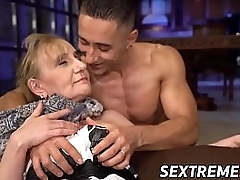 Tantalizing granny seduces young timber