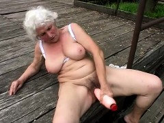 Stacked of age unsubtle fucks a obese dildo plus mill the brush brashness on a cock