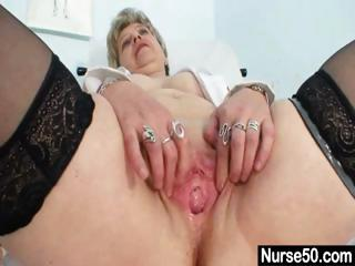 Busty granny in unchangeable stretching her elderly pussy