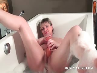 Nasty grown-up masturbates in bathtub