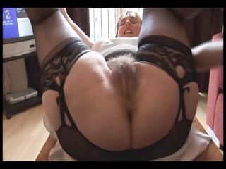 Hairy busty matured lady in slip and girdle does upskirt and spoof show
