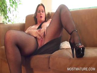 Busty of age pleasing twat on couch