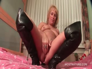 Mature not far from leather scullery-maid doing herself not far from bed