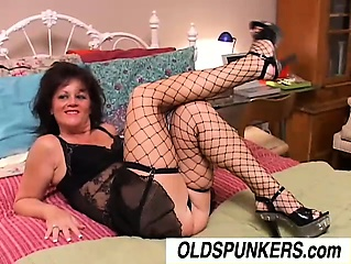 Sexy elderly spunker in stockings Debella enjoys a facial cumshot