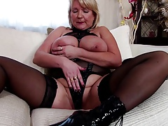 Mature mother dressed like a slut with ample boobs