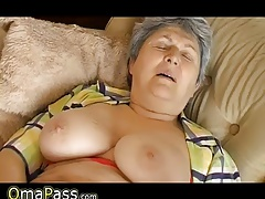 Grandma with fat sagging tits masturbating on the couch