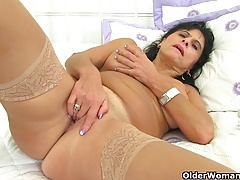 British milf Raven fucks her cunny with her thumbs