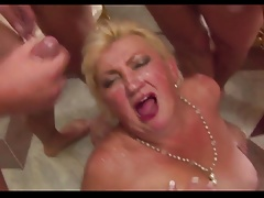 Grandmother gets cummed by 5 guys.