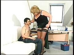 Blonde granny in stockings turns on a  man