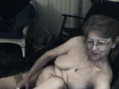 Granny really enjoys thrusting her playthings in her old pussy